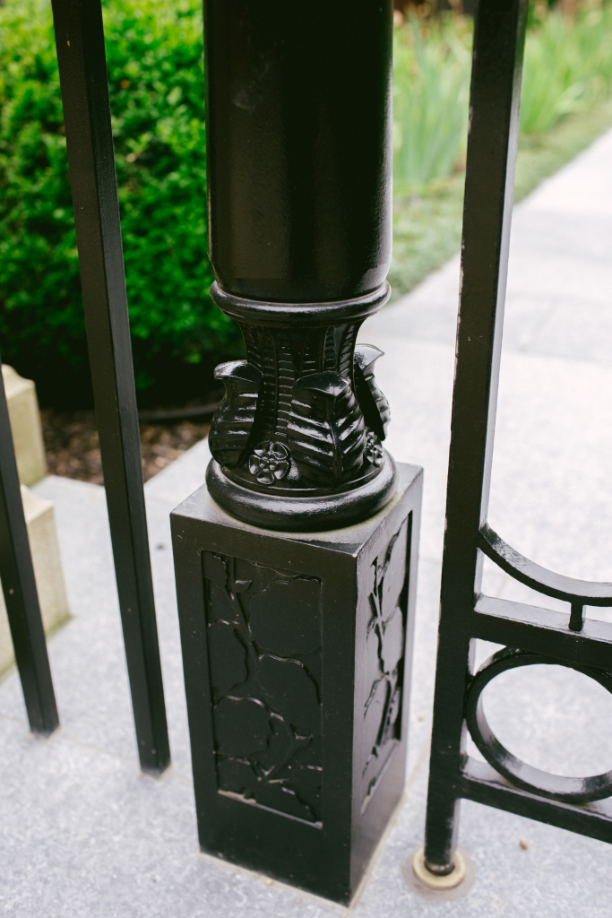 Metal garden gate post with leaf and flower decoration