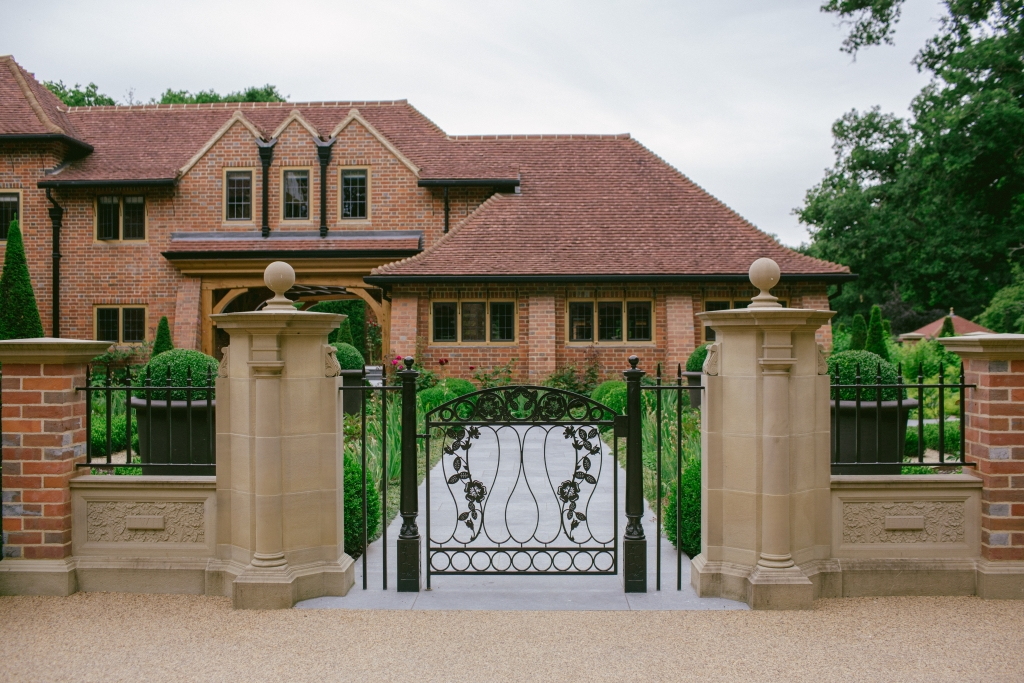Entrance to courtyard garden with ornate metal gate