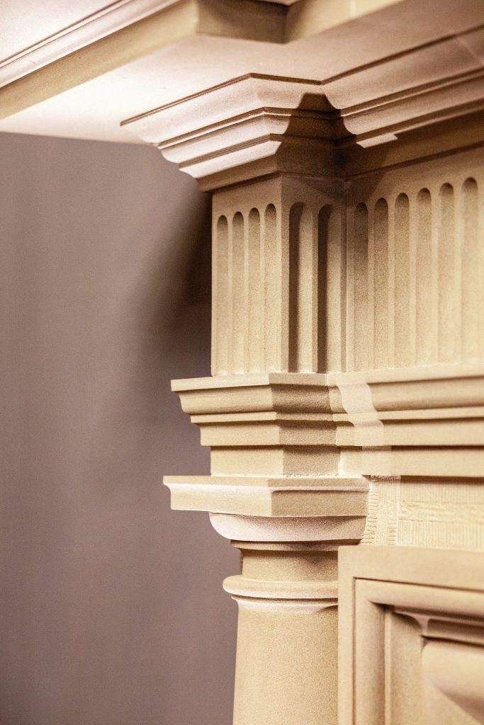Classical sandstone fireplace
