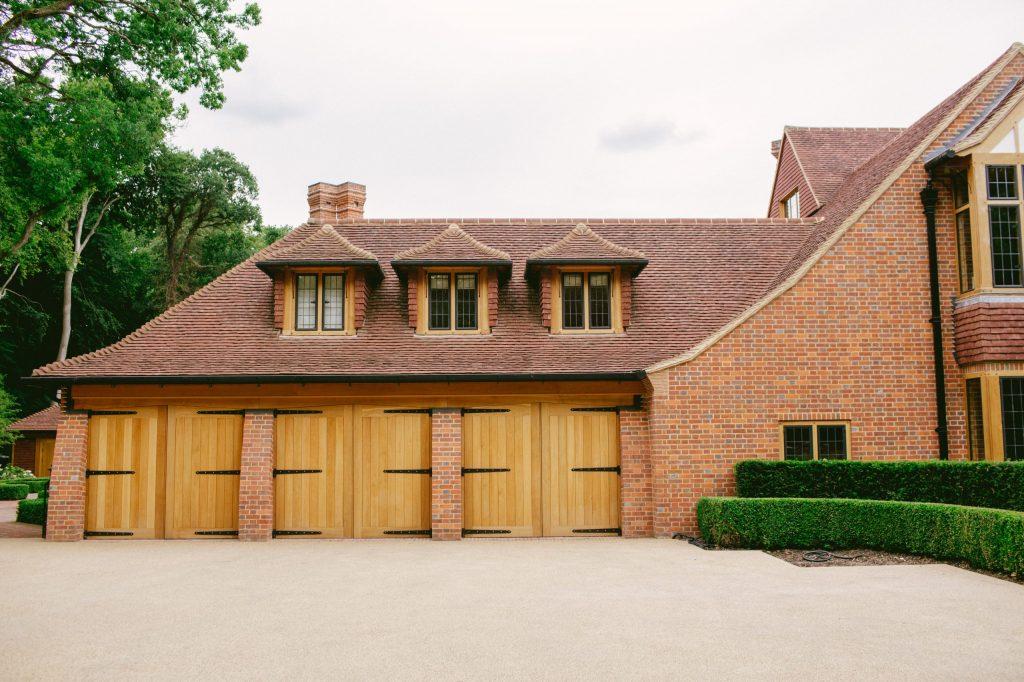 Arts and Crafts brick and Oak garage wing
