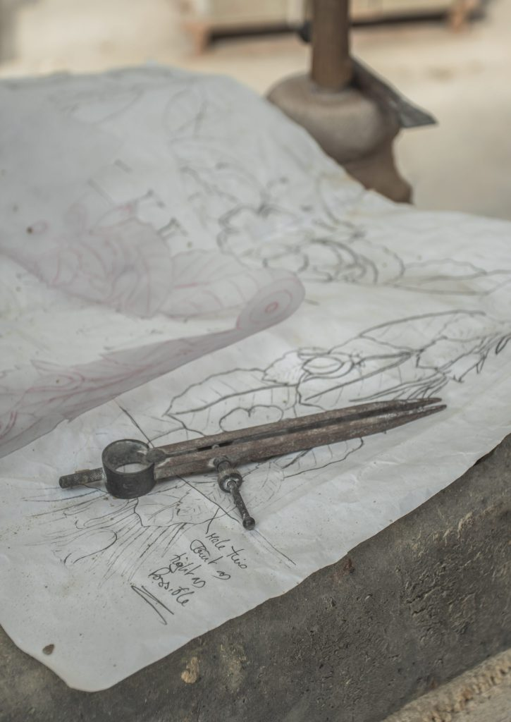 Stone mason working from Architect drawings