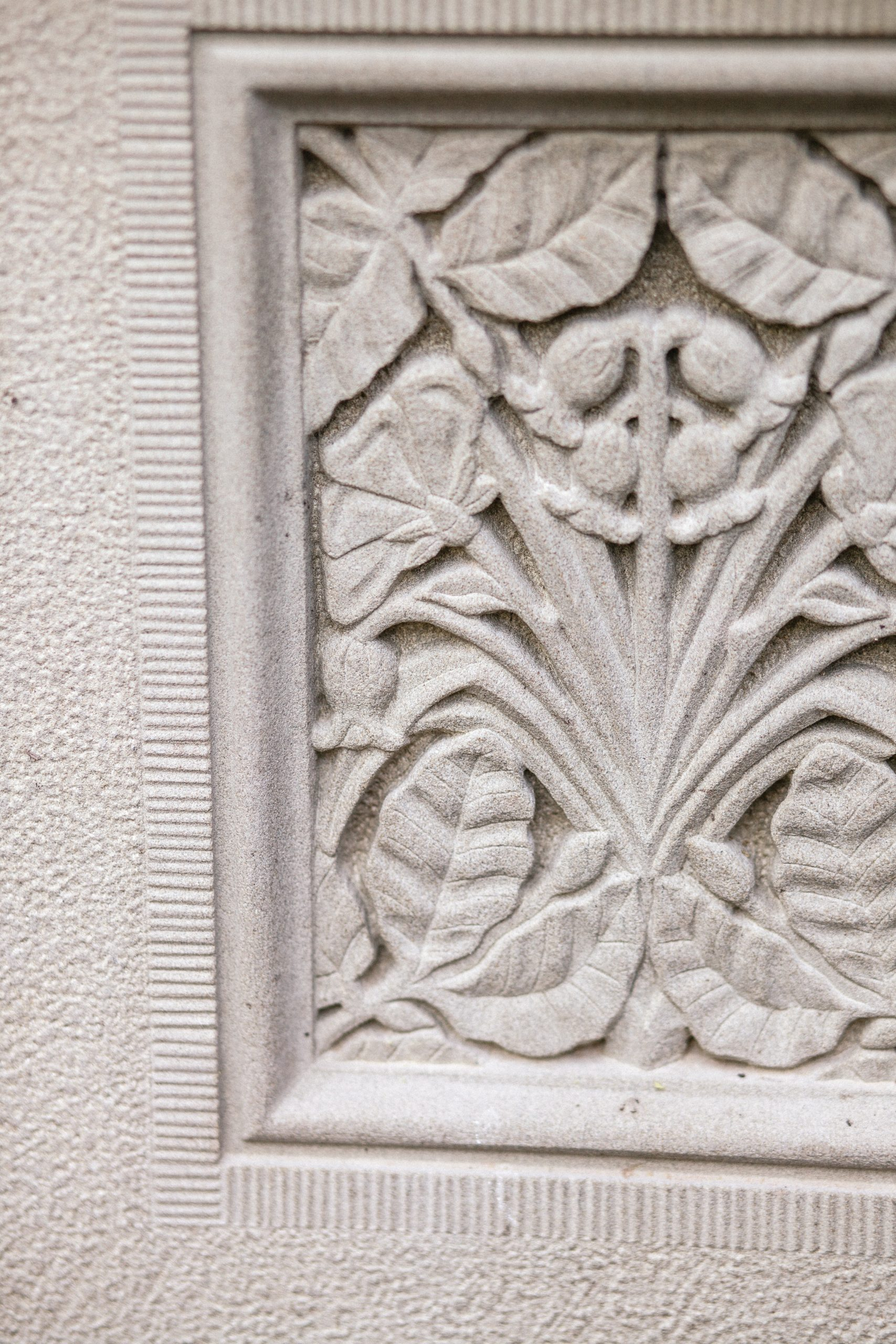 Stone carving of beech leaves and dog roses