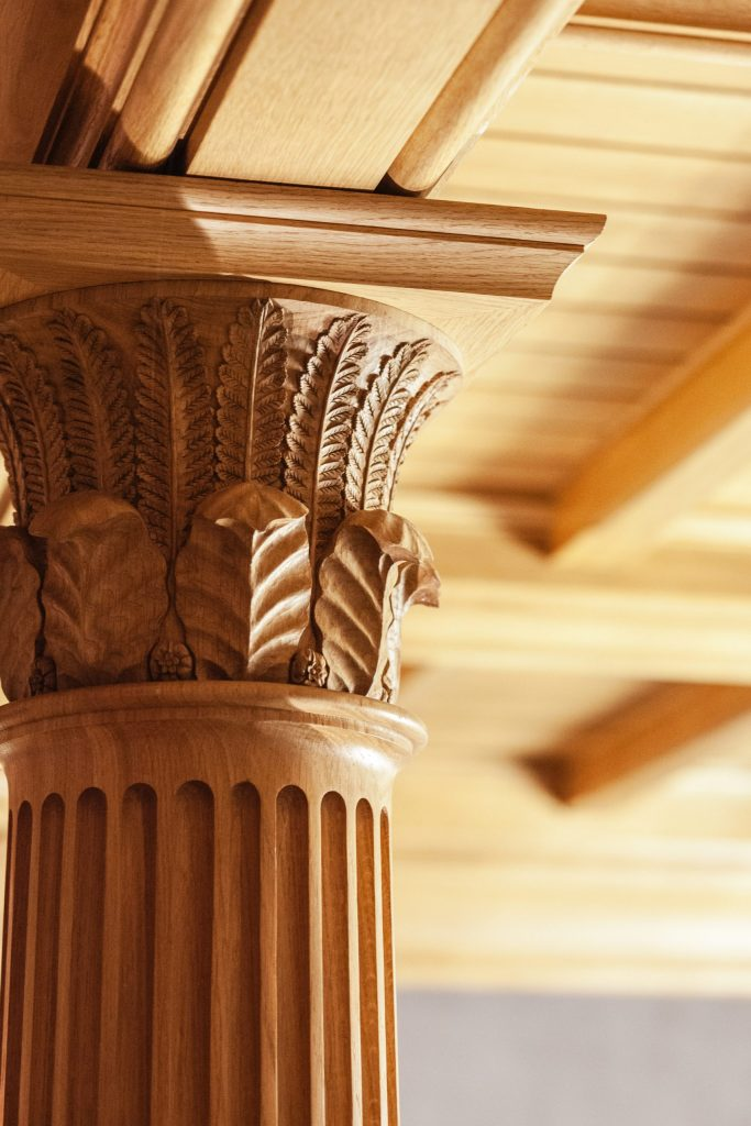 Ornate carved Oak column capital with leaves
