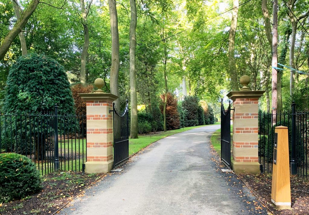 New stone and brick estate entrance gate piers