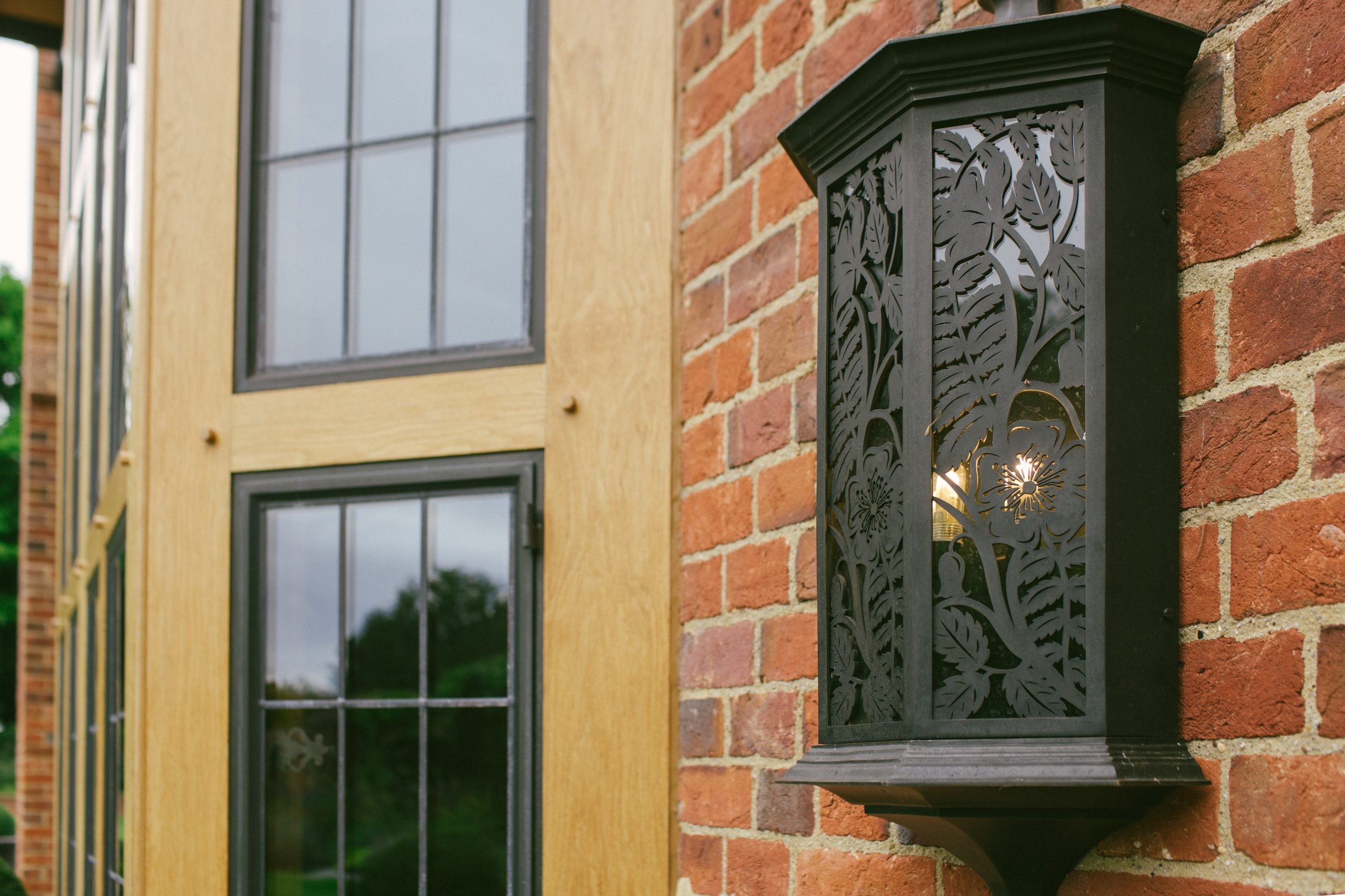 Bespoke garden wall lights in metal and glass