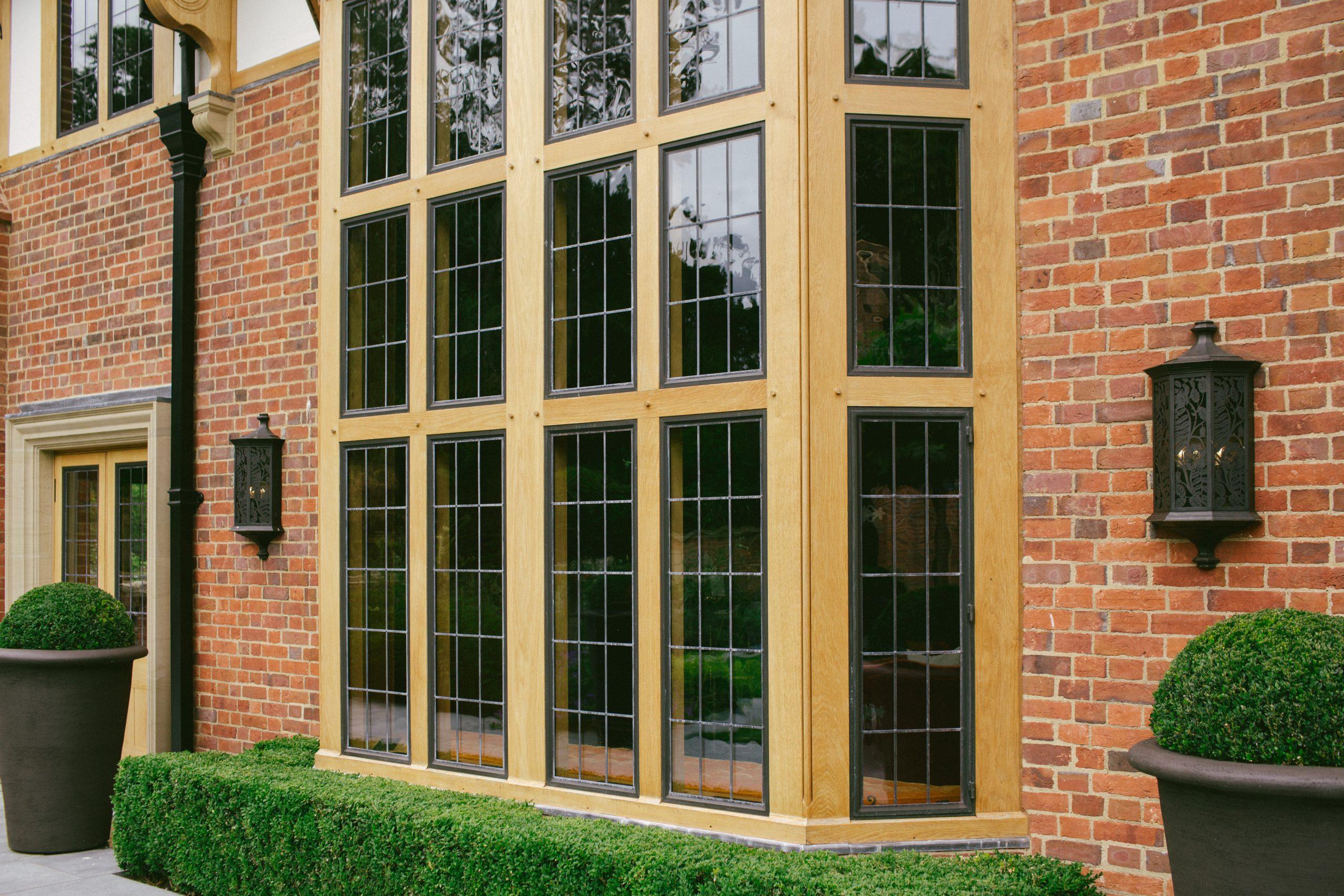 Bronze casement windows in large Oak bay window
