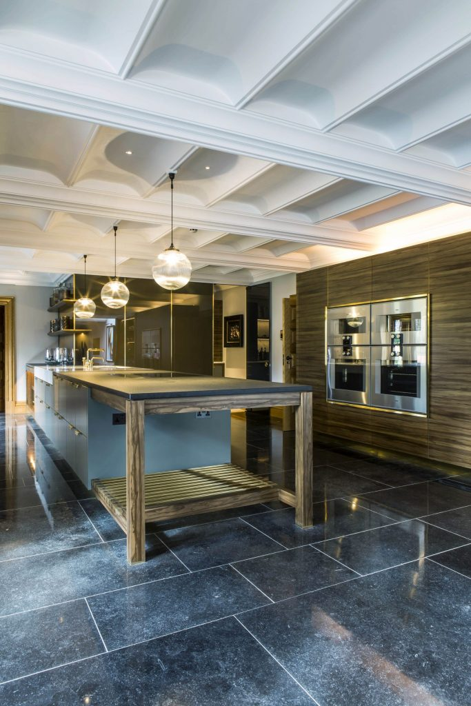 Contemporary kitchen with classical plaster ceiling