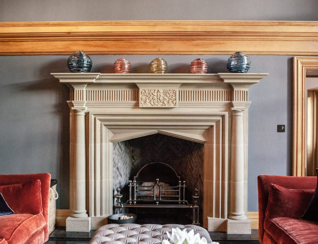 Ornate Classical stone carved fireplace