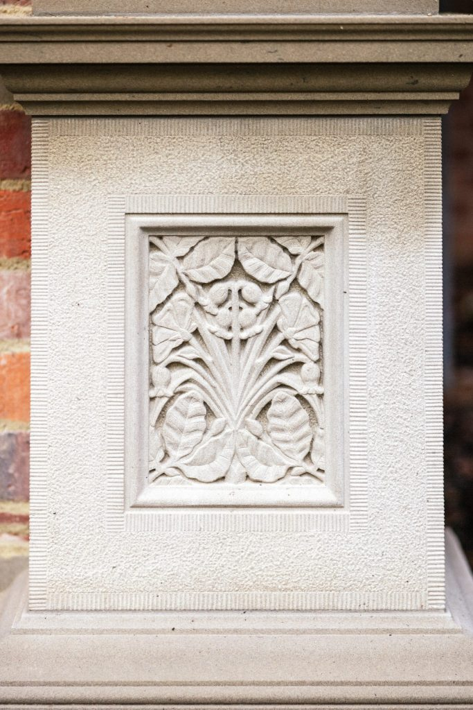 Classical stone carving with British flora