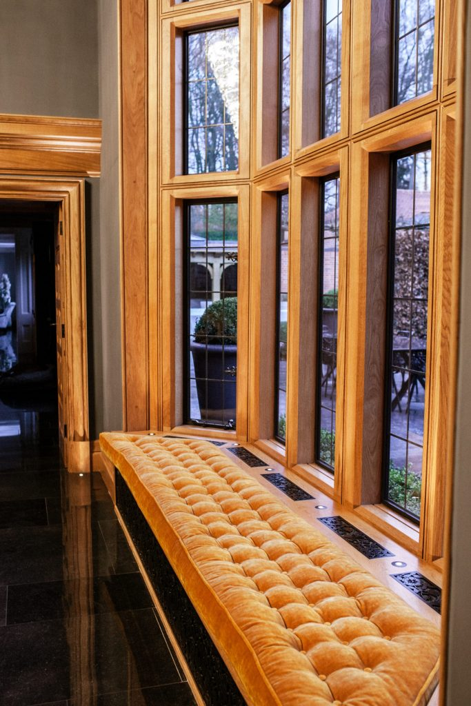 Double height tall Oak bay window with bronze casements