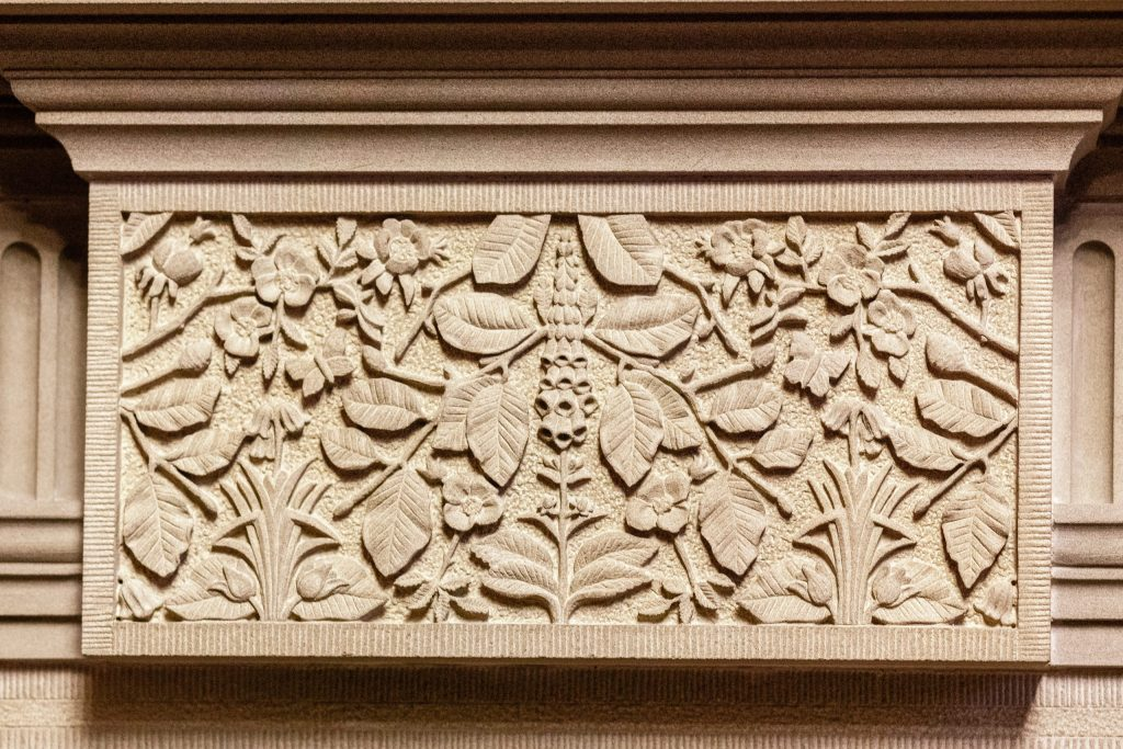 Ornate stone carving of leaves and flowers