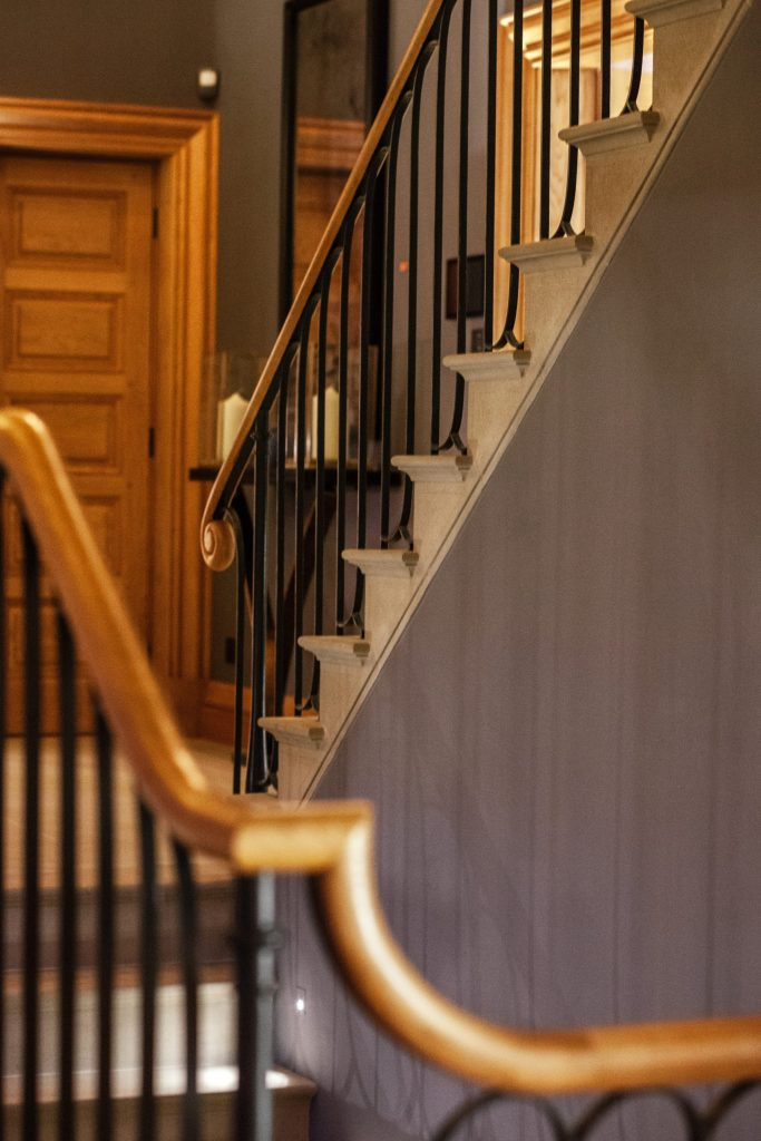 Metal railings with carved Oak handrail in Arts and Crafts house