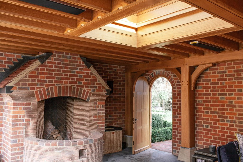Outdoor fire pit and garden fireplace in Arts and Crafts garden