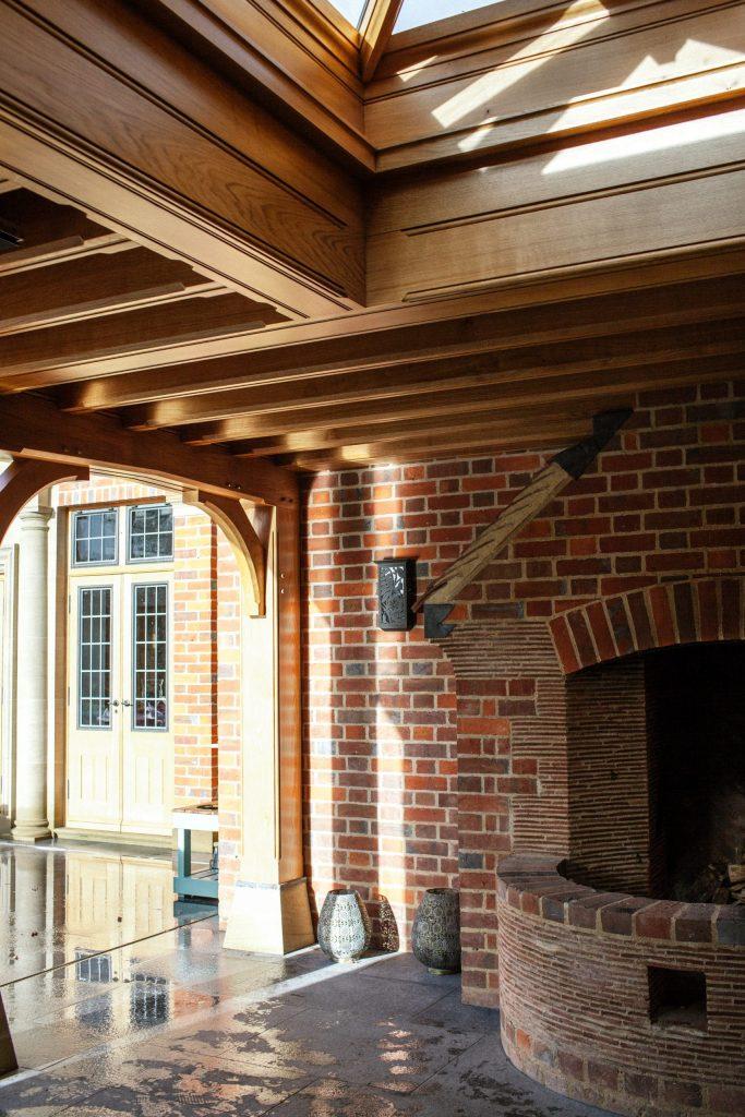 Outdoor patio fireplace in English garden