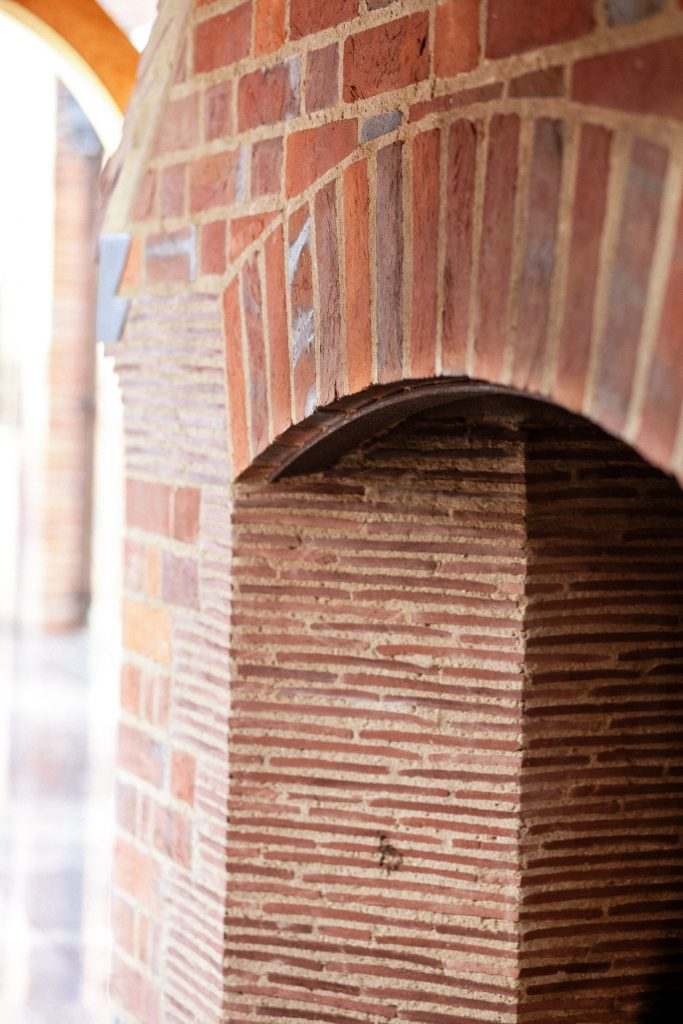 Brick and tile outdoor garden fireplace pit