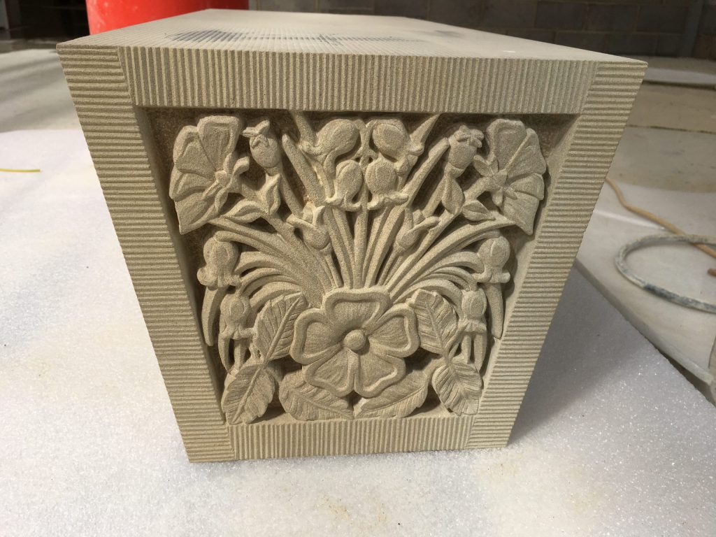 Floral stone carving for keystone on garden building