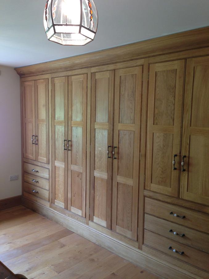 Bespoke Oak fitted wardrobes in master bedroom