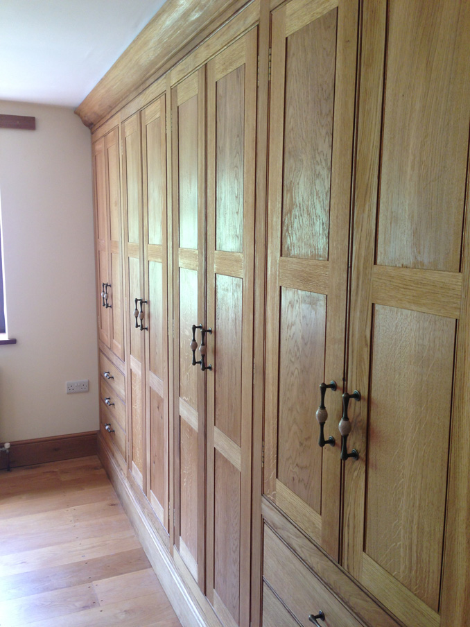 Joiner made fitted Oak wardrobes traditional design