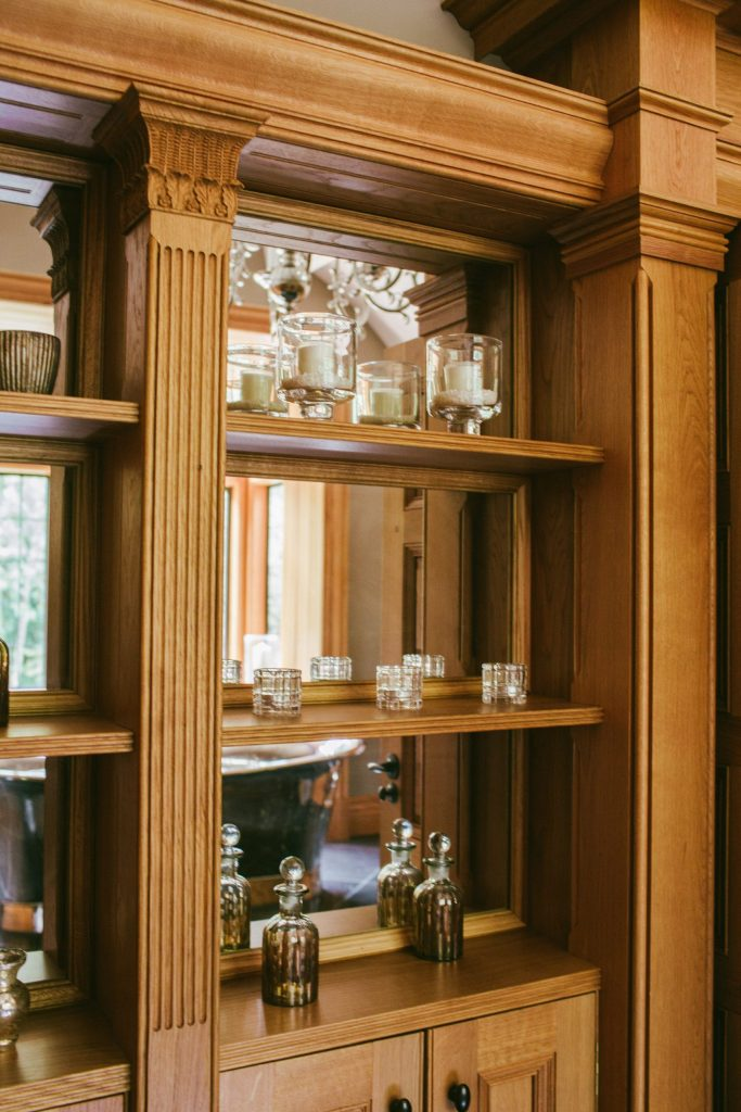 Oak and mirror classical cabinet with columns