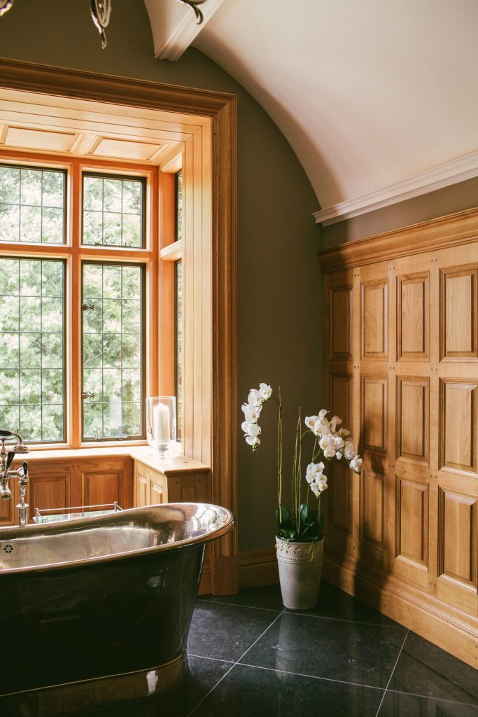 Arched classical plaster ceiling with Oak panelled walls