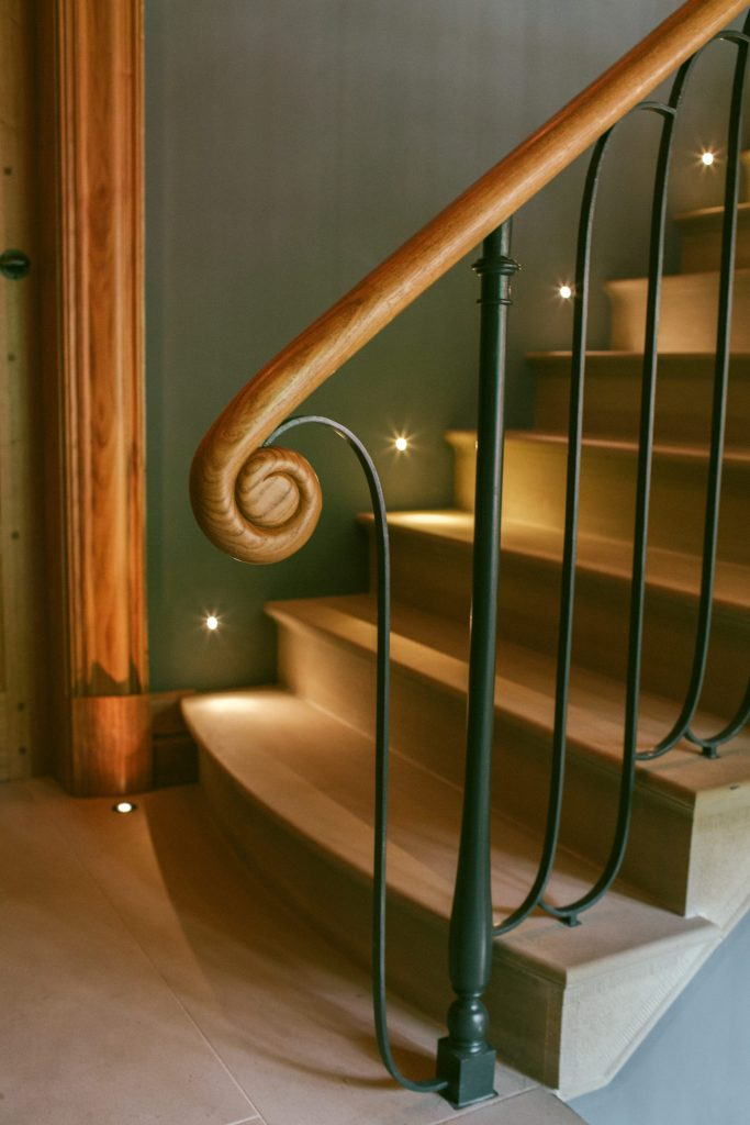 Arts and Crafts hand carved scroll handrail
