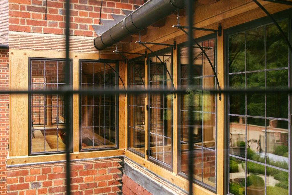 Arts and Crafts Oak windows with bronze casements