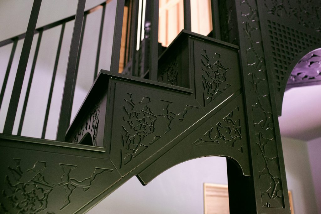 Black metal staircase with leaves and flower design