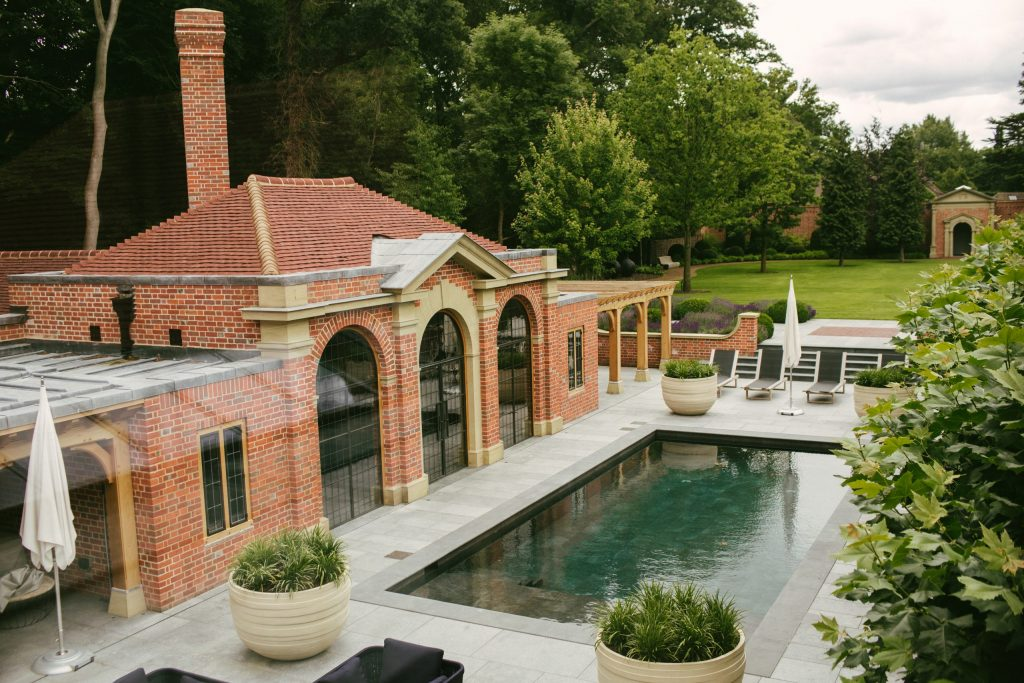 Classical brick garden pool house