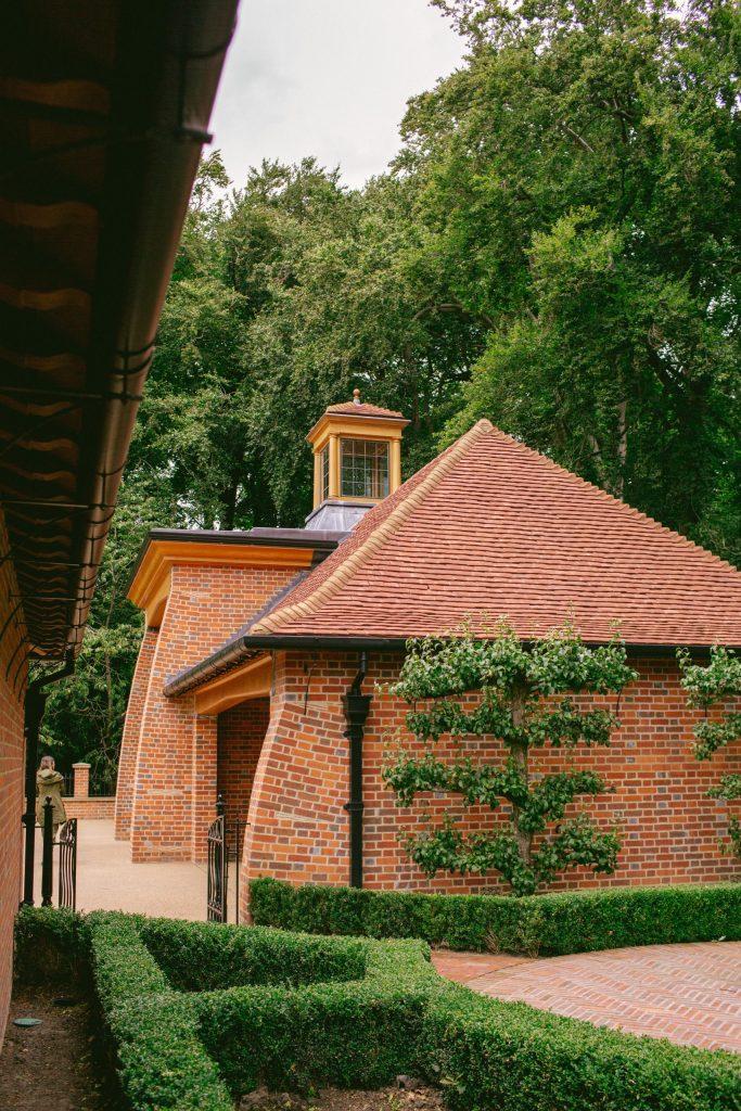Arts and Crafts brick and Oak estate gatehouse
