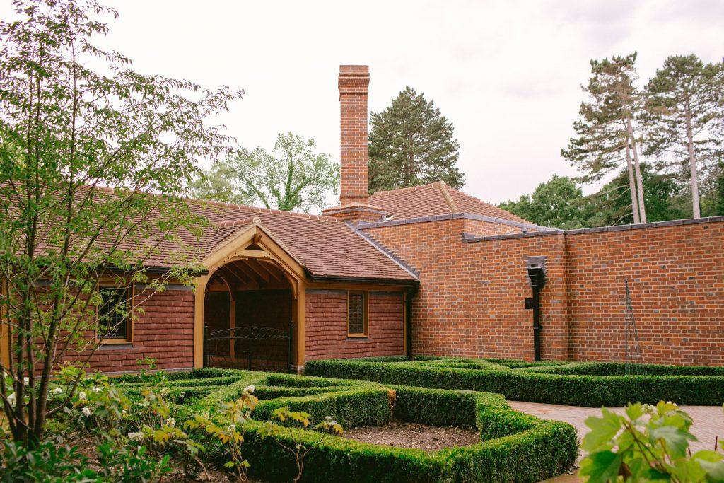Oak frame building with tile cladding