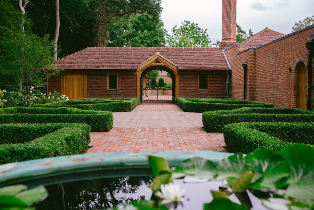 Arts and Crafts courtyard garden design and stables