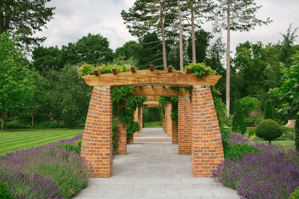 Arts and Crafts brick and Oak loggia design