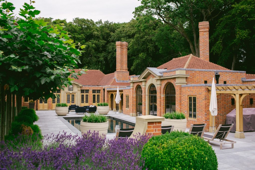 Classical summerhouse, spa and pool in country house garden design