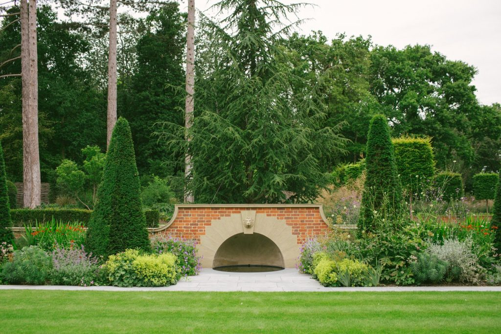 Classical stone arched fountain and pool