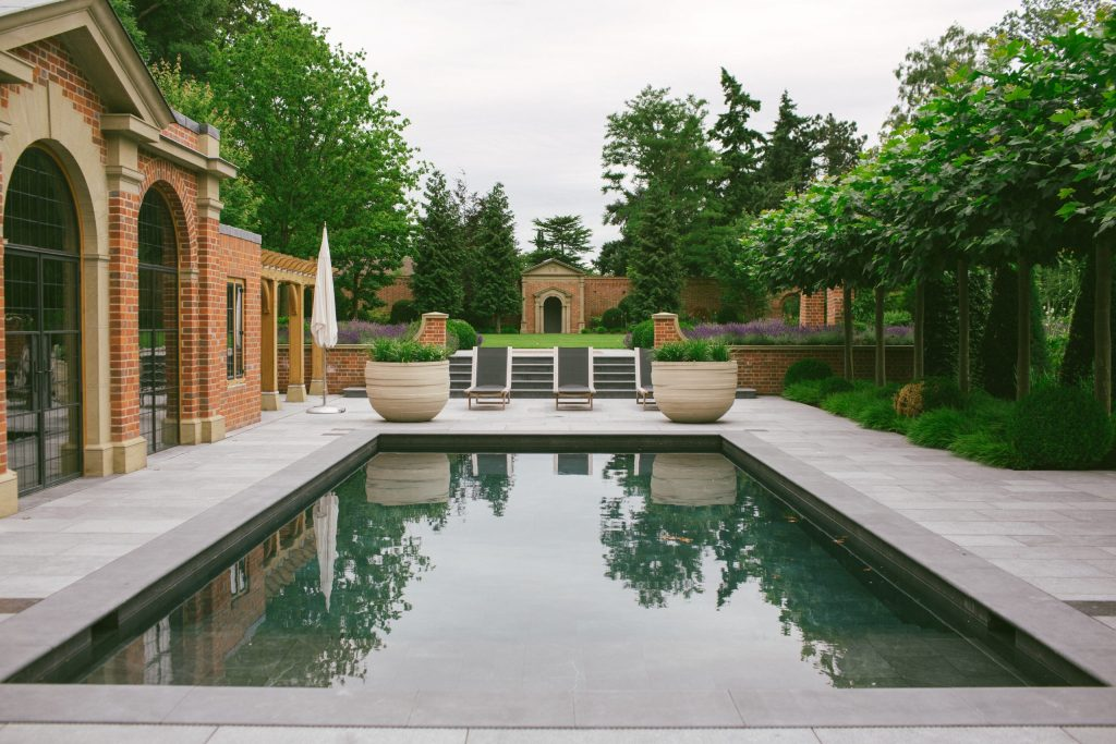 Outdoor swimming pool and spa building in country house gardens