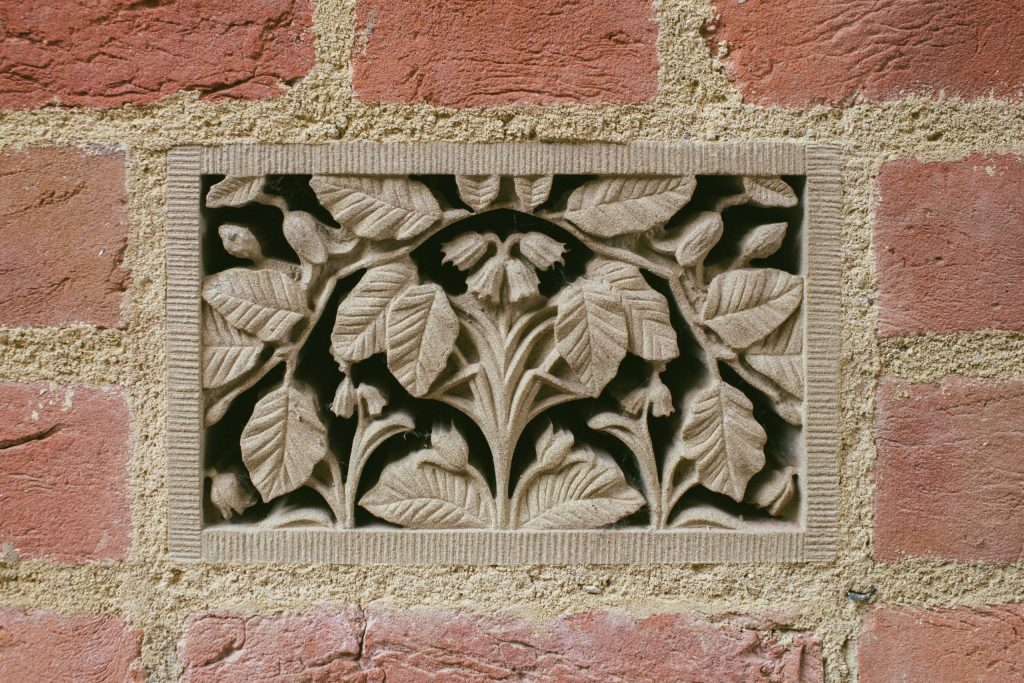 Stone carving with British flowers