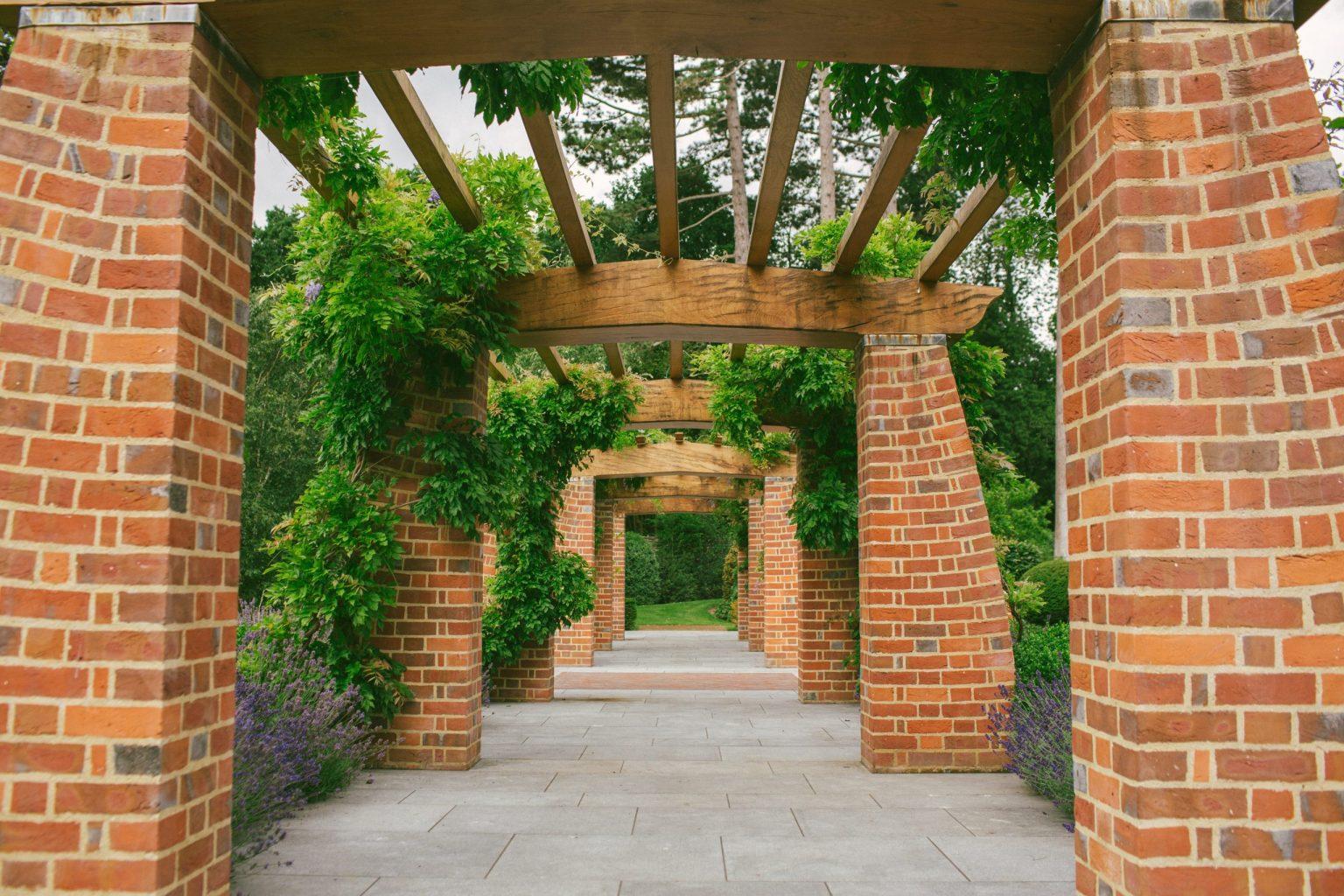 Brick and Oak garden pergola in Arts and Crafts garden