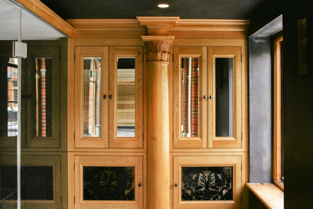 Bespoke Oak carved cupboard with mirrors