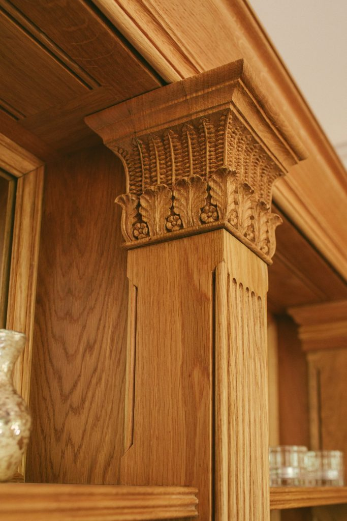 Classical Oak carving on fitted cabinet