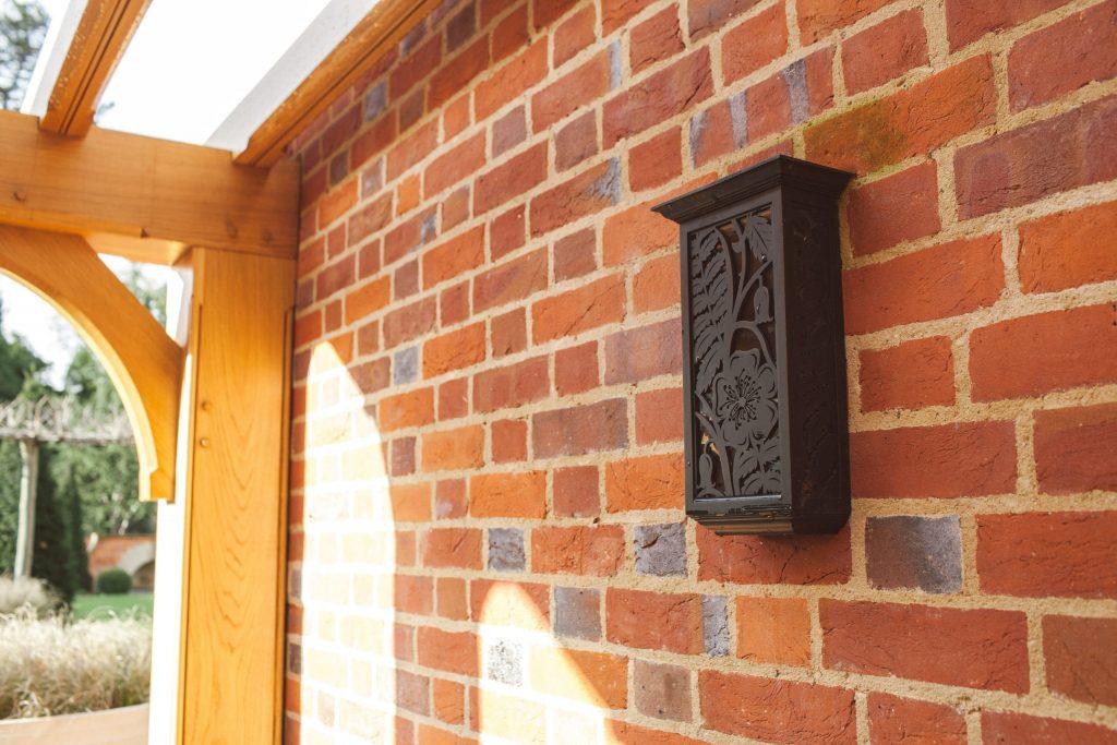 Decorative bronze garden wall light