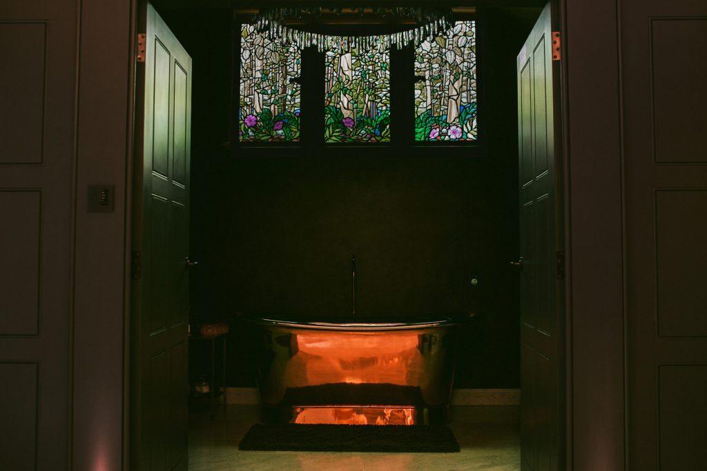 Triptych stained glass window in luxury bathroom