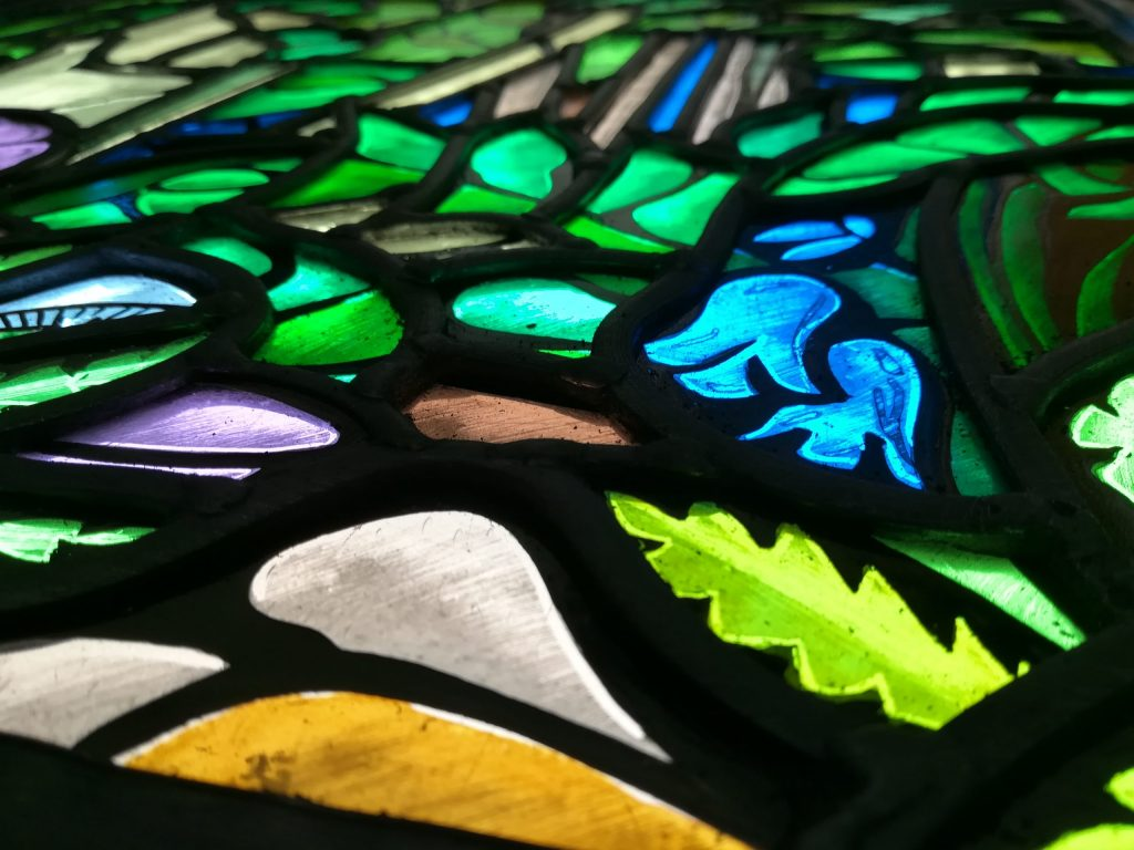 Stained glass window with bluebells
