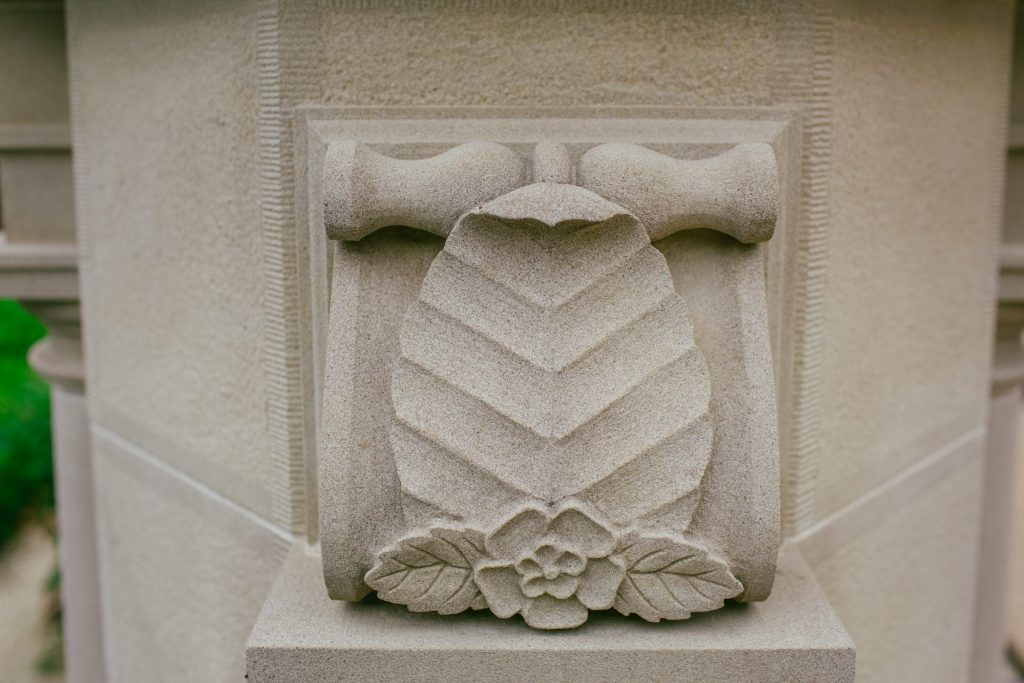 Stone carving with British flowers and leaves
