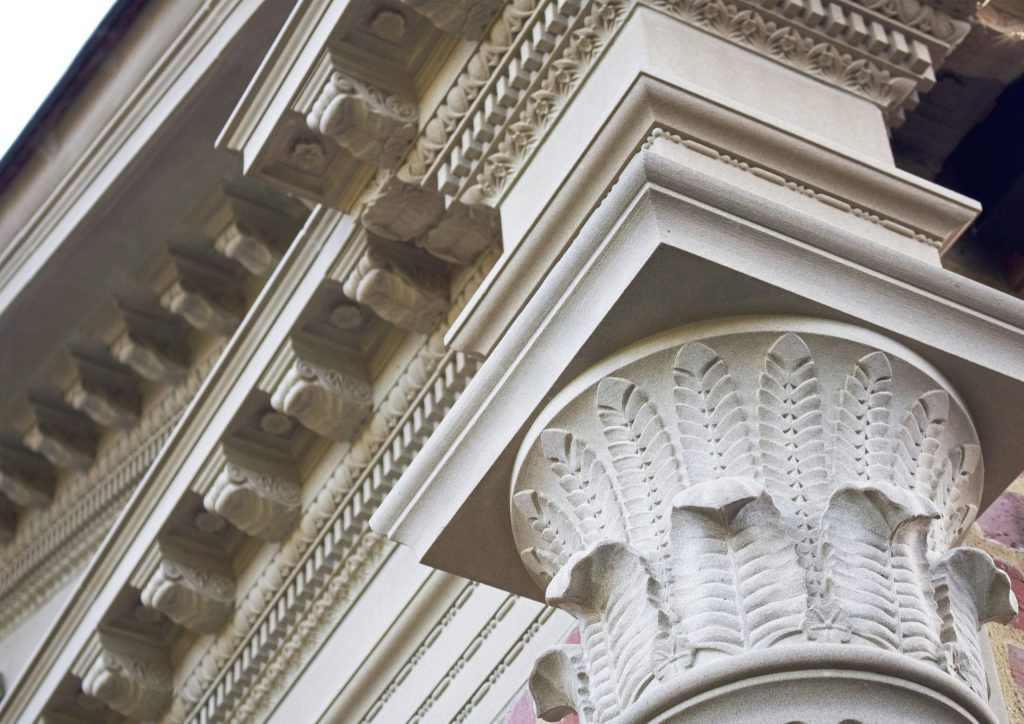 Ornate classical stone carvings on new building