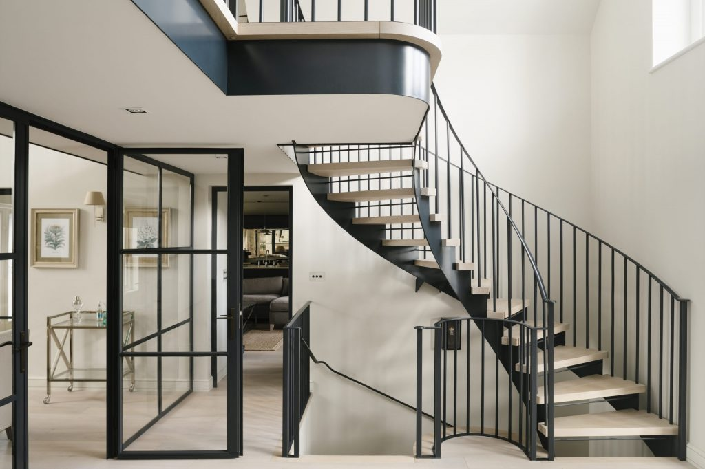 Modern metal and glass doors with matching staircase