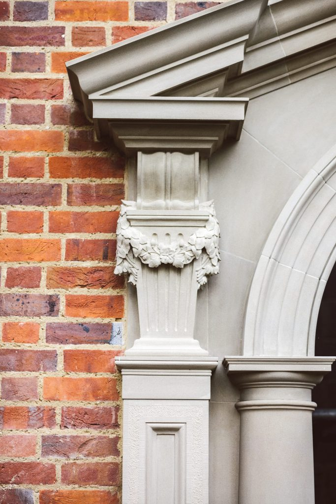 Stone carved floral swag on classical garden building