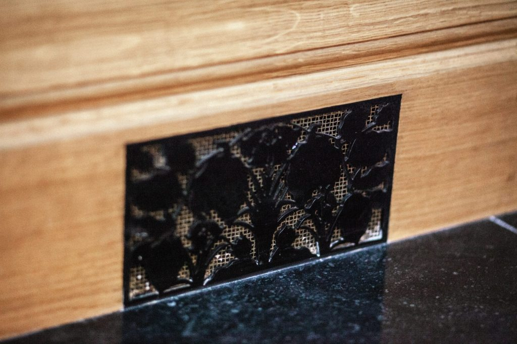 Bespoke metal vent covers with leaf decoration