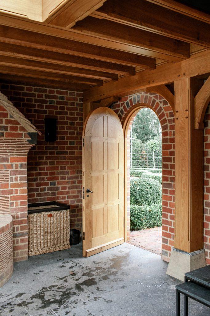 Oak panelled garden door in brick wall