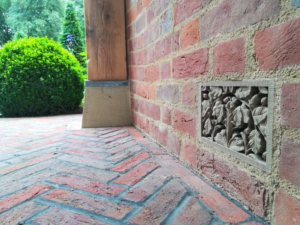 Carved stone decorative air brick in country house