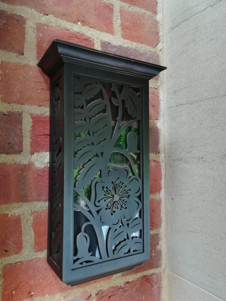 Bronze garden wall lights with cut out metal and glass